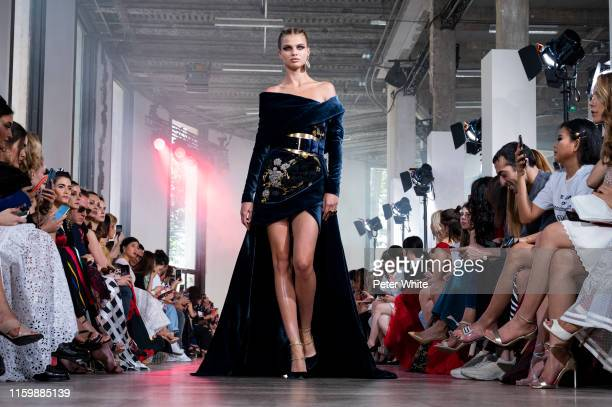 Model walks the runway during the Elie Saab Haute Couture Fall/Winter 2019 2020 show as part of Paris Fashion Week on July 03, 2019 in Paris, France.