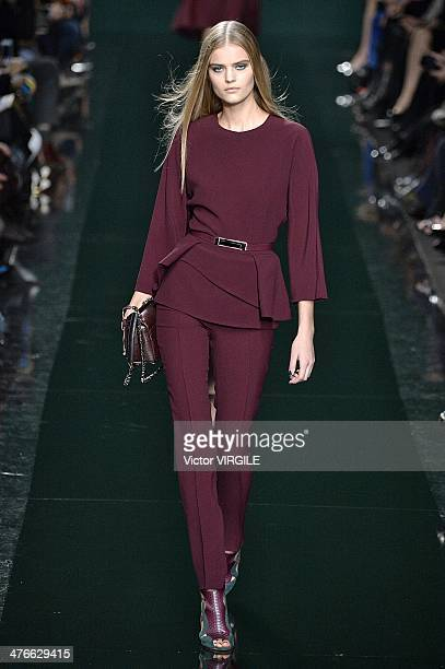 A model walks the runway during the Elie Saab Ready to Wear Fall/Winter 20142015 show as part of the Paris Fashion Week Womenswear Fall/Winter...