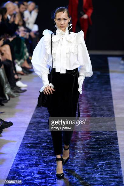 Model walks the runway during the Elie Saab show as part of Paris Fashion Week Womenswear Fall/Winter 2020/2021 on February 29, 2020 in Paris, France.