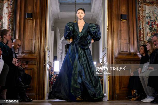 A model walks the runway during the Elie Saab show as part of the Paris Fashion Week Womenswear Fall/Winter 2019/2020 on March 02 2019 in Paris France