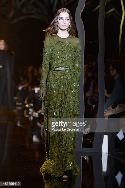A model walks the runway during the Elie Saab show as part of the Paris Fashion Week Womenswear Fall/Winter 2015/2016 on March 7 2015 in Paris France