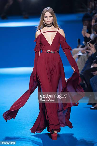 A model walks the runway during the Elie Saab show as part of the Paris Fashion Week Womenswear Fall/Winter 2016/2017 on March 5 2016 in Paris France