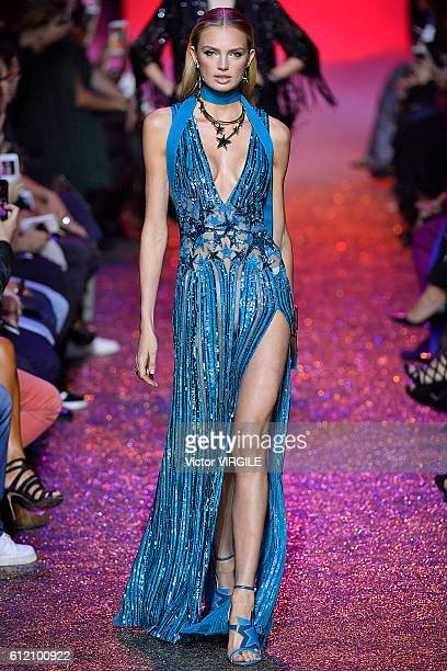 A model walks the runway during the Elie Saab show as part of the Paris Fashion Week Womenswear Spring/Summer 2017 on October 1 2016 in Paris France