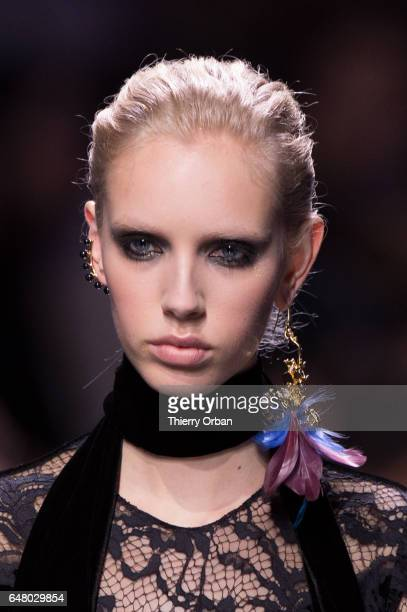 A model walks the runway during the Elie Saab show as part of the Paris Fashion Week Womenswear Fall/Winter 2017/2018 on March 4 2017 in Paris France