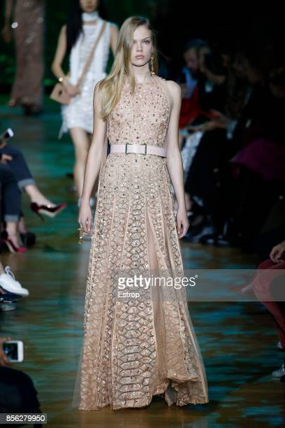 A model walks the runway during the Elie Saab show as part of the Paris Fashion Week Womenswear Spring/Summer 2018 on September 30 2017 in Paris...