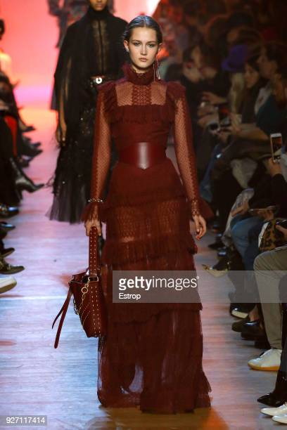 A model walks the runway during the Elie Saab show as part of the Paris Fashion Week Womenswear Fall/Winter 2018/2019 on March 3 2018 in Paris France