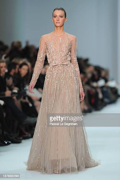 A model walks the runway during the Elie Saab Spring/Summer 2012 HauteCouture Show as part of Paris Fashion Week at Grand Palais on January 25 2012...