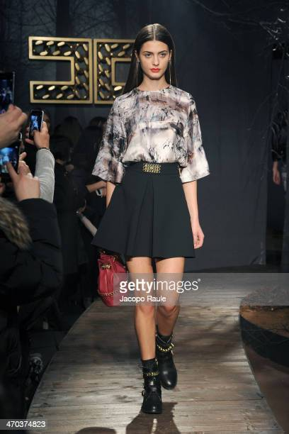 A model walks the runway during the Elisabetta Franchi Presentation during Milan Fashion Week Womenswear Autumn/Winter 2014 on February 19 2014 in...