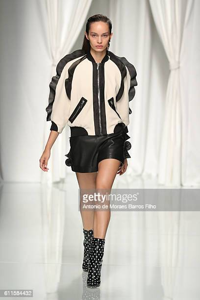 A model walks the runway during the Emanuel Ungaro show as part of the Paris Fashion Week Womenswear Spring/Summer 2017 on September 30 2016 in Paris...
