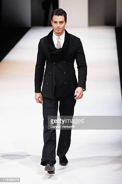 Model walks the runway during the Emporio Armani fashion show as part of Milan Fashion Week Autumn/Winter 2008/09 on February 17, 2008 in Milan,...