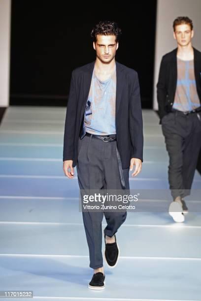 Model walks the runway during the Emporio Armani fashion show as part of Milan Fashion Week Menswear Spring/Summer 2012 on June 19, 2011 in Milan,...