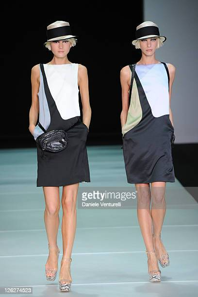Model walks the runway during the Emporio Armani fashion show as part of Milan Fashion Week Womenswear Spring/Summer 2012 on September 24, 2011 in...
