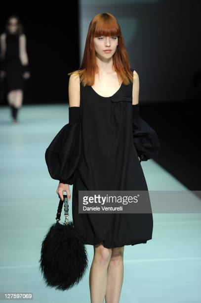 Model walks the runway during the Emporio Armani fashion show as part of Milan Fashion Week Womenswear Autumn/Winter 2011 on February 26, 2011 in...