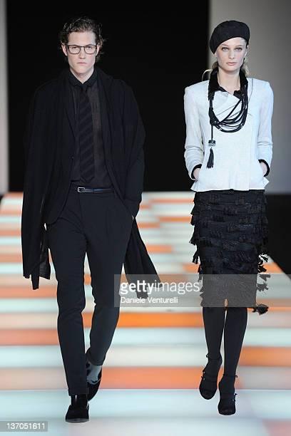 Model walks the runway during the Emporio Armani fashion show as part of Milan Fashion Week Menswear Autumn/Winter 2012 on January 15, 2012 in Milan,...