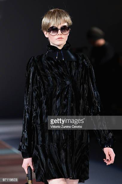 A model walks the runway during the Emporio Armani Milan Fashion Week Womenswear Autumn/Winter 2010 show on February 26 2010 in Milan Italy
