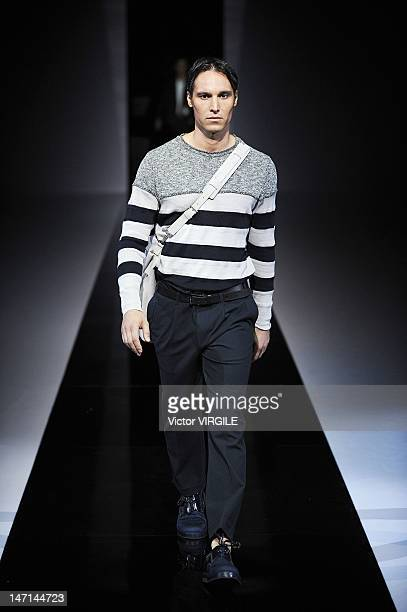 Model walks the runway during the Emporio Armani ready to Wear Spring/Summer 2013 show as part of the Milan Men Fashion Week on June 25, 2012 in...