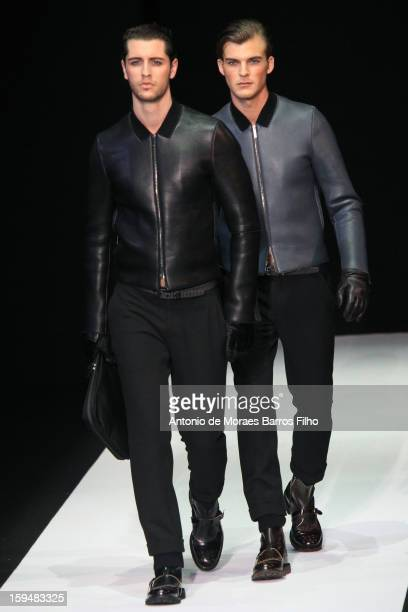 Model walks the runway during the Emporio Armani show as a part of Milan Fashion Week Menswear Autumn/Winter 2013 on January 14, 2013 in Milan, Italy.