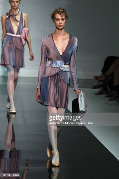 A model walks the runway during the Emporio Armani show as a part of Milan Fashion Week Womenswear Spring/Summer 2014 on September 20 2013 in Milan...