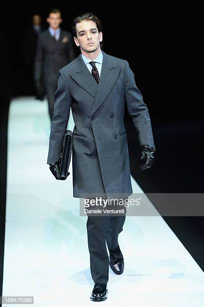 Model walks the runway during the Emporio Armani show as part of Milan Fashion Week Menswear Autumn/Winter 2013 on January 14, 2013 in Milan, Italy.