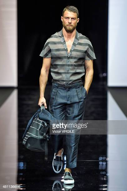 Model walks the runway during the Emporio Armani show as part of Milan Fashion Week Menswear Spring/Summer 2015 on June 23, 2014 in Milan, Italy.