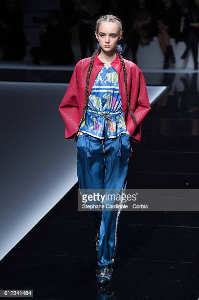 A model walks the runway during the Emporio Armani show as part of the Paris Fashion Week Womenswear Spring/Summer 2017on October 3 2016 in Paris...