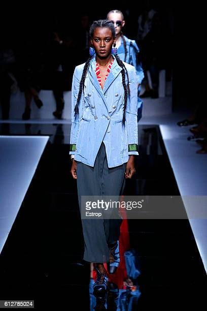 A model walks the runway during the Emporio Armani show as part of the Paris Fashion Week Womenswear Spring/Summer 2017 on October 3 2016 in Paris...