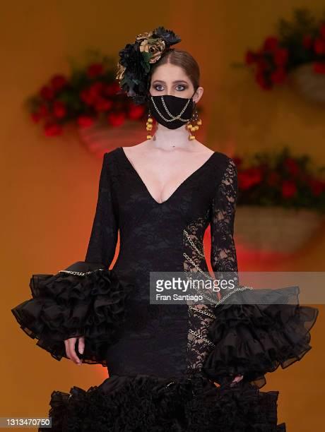 Model walks the runway during the Emprende Lunares Flamenco Fashion show on April 20, 2021 in Seville, Spain.