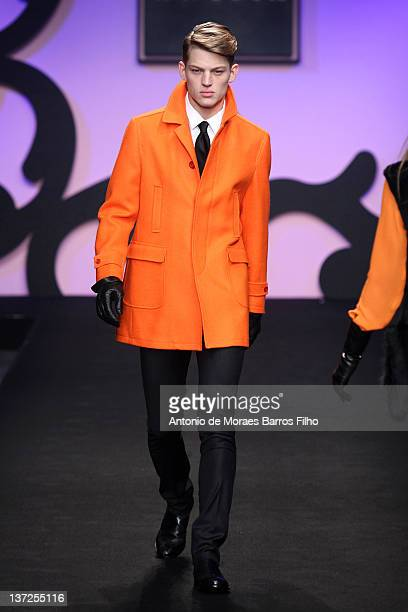 Model walks the runway during the Enrico Coveri fashion show as part of Milan Fashion Week Menswear Autumn/Winter 2012 on January 17, 2012 in Milan,...