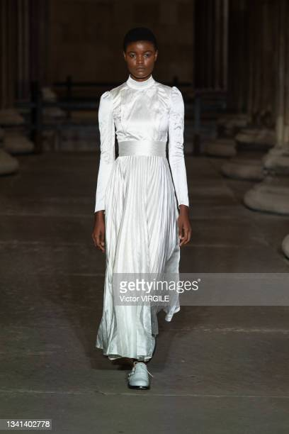 Model walks the runway during the Erdem Ready to Wear Spring/Summer 2022 fashion show as part of the London Fashion Week at The British Museum on...