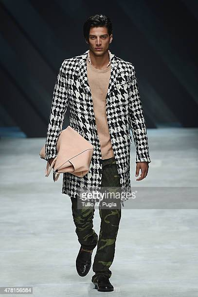 Model walks the runway during the Ermanno Scervino fashion show as part of Milan Men's Fashion Week Spring/Summer 2016 on June 23, 2015 in Milan,...