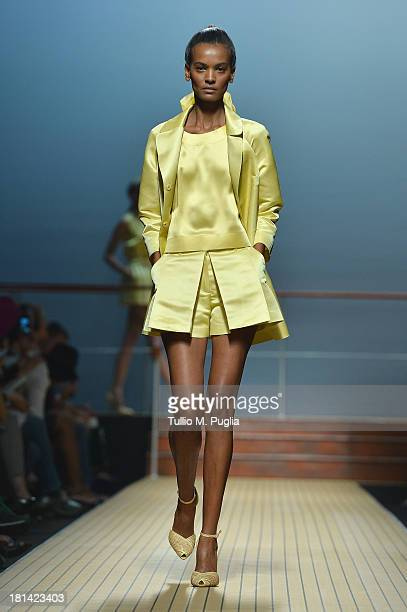 A model walks the runway during the Ermanno Scervino show as a part of Milan Fashion Week Womenswear Spring/Summer 2014 on September 21 2013 in Milan...