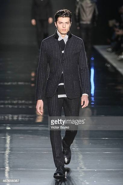 A model walks the runway during the Ermanno Scervino show as a part of Milan Fashion Week Menswear Autumn/Winter 2014 on January 14 2014 in Milan...