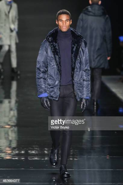 A model walks the runway during the Ermanno Scervino show as part of Milan Fashion Week Menswear Autumn/Winter 2014 on January 14 2014 in Milan Italy