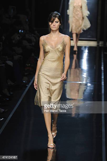 A model walks the runway during the Ermanno Scervino show as part of Milan Fashion Week Womenswear Autumn/Winter 2014 on February 22 2014 in Milan...