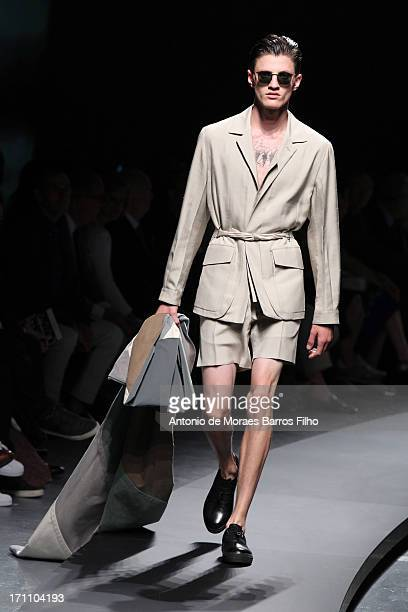 A model walks the runway during the Ermenegildo Zegna as a part of MFW S/S 2014 on June 22 2013 in Milan Italy