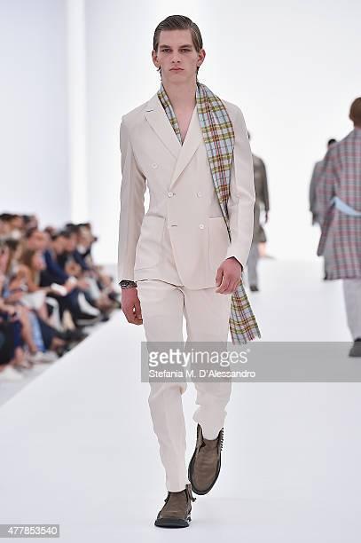 A model walks the runway during the Ermenegildo Zegna fashion show as part of Milan Men's Fashion Week Spring/Summer 2016 on June 20 2015 in Milan...