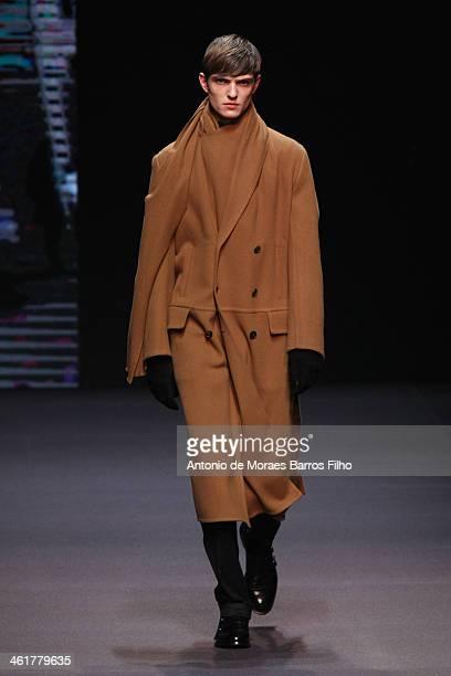 Model walks the runway during the Ermenegildo Zegna show as a part of Milan Fashion Week Menswear Autumn/Winter 2014 on January 11, 2014 in Milan,...