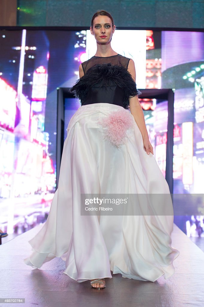 A model walks the runway during the Esposa show at Yas Mall on October 18, 2015 in Abu Dhabi, United Arab Emirates.