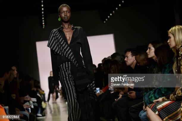 A model walks the runway during the Esteban Cortazar Fall 2018 Runway Show at Spring Studios on February 14 2018 in New York City