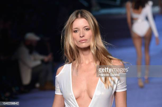 A model walks the runway during the ETAM show as part of the Paris Fashion Week Womenswear Spring/Summer 2019 on September 25 2018 in Paris France