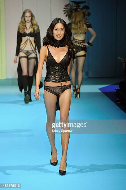 A model walks the runway during the ETAM show as part of the Paris Fashion Week Womenswear Fall/Winter 2015/2016 at Piscine Molitor on March 3 2015...