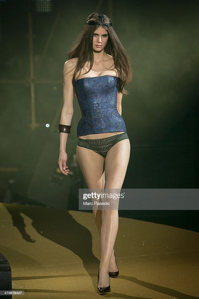 A model walks the runway during the ETAM show as part of the Paris Fashion Week Womenswear Fall/Winter 2014-2015 on February 25, 2014 in Paris, France.