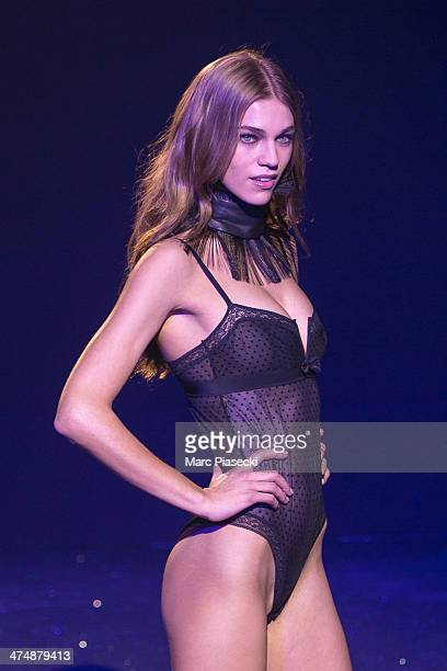 A model walks the runway during the ETAM show as part of the Paris Fashion Week Womenswear Fall/Winter 20142015 on February 25 2014 in Paris France