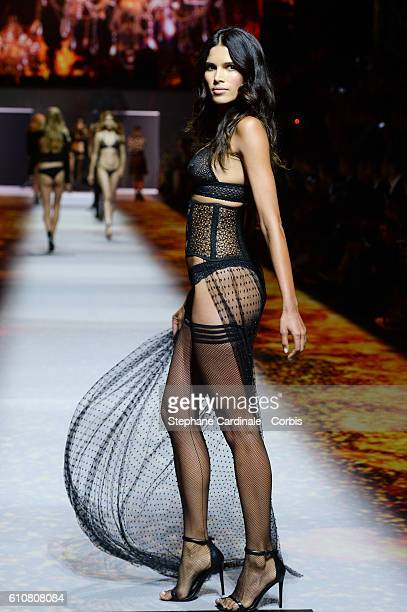 Model walks the runway during the Etam show as part of the Paris Fashion Week Womenswear Spring/Summer 2017 on September 27, 2016 in Paris, France.