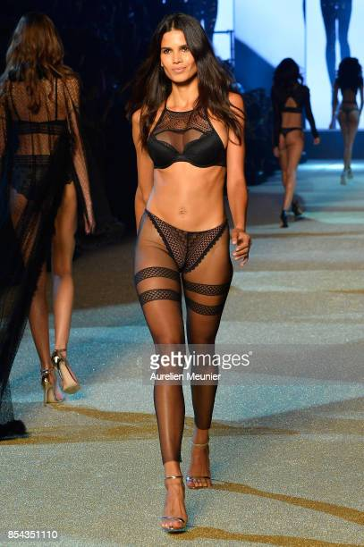 A model walks the runway during the Etam show as part of the Paris Fashion Week Womenswear Spring/Summer 2018 on September 26 2017 in Paris France