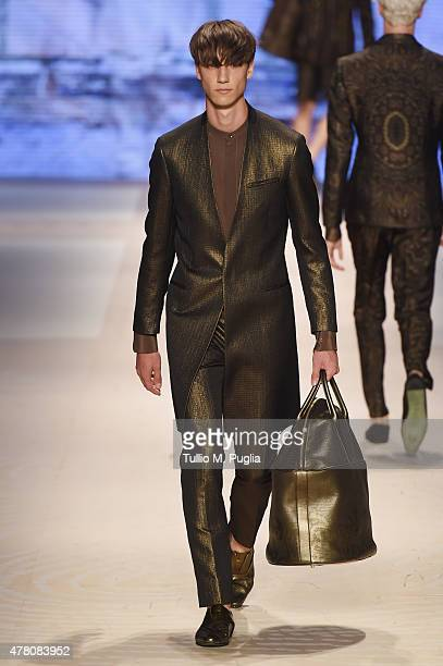 A model walks the runway during the Etro fashion show as part of Milan Men's Fashion Week Spring/Summer 2016 on June 22 2015 in Milan Italy