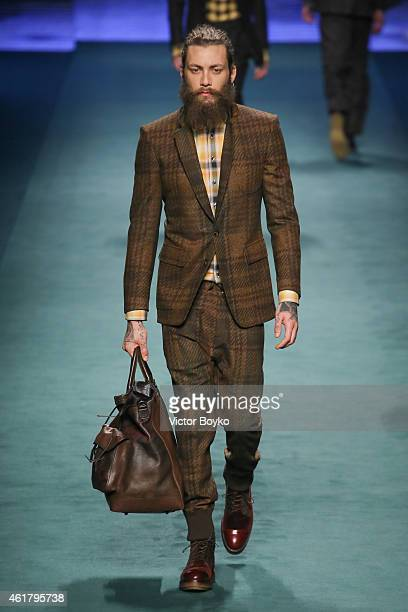 A model walks the runway during the Etro Show as a part of Milan Menswear Fashion Week Fall Winter 2015/2016 on January 19 2015 in Milan Italy