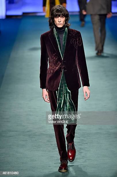 A model walks the runway during the Etro show as a part of Milan Menswear Fashion Week Fall Winter on January 19 2015 in Milan Italy