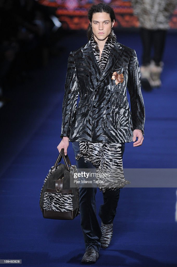 A model walks the runway during the Etro show as part of Milan Fashion Week Menswear Autumn/Winter 2013 on January 14, 2013 in Milan, Italy.