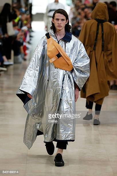 A model walks the runway during the Etudes Menswear Spring/Summer 2017 show as part of Paris Fashion Week on June 25 2016 in Paris France